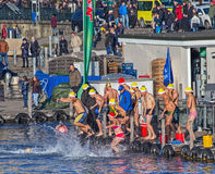 Zurich Samichlaus-Schwimmen participants jumping into the water Royalty Free Stock Images
