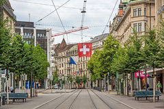 Zurich shopping street Bahnhofstrasse with swiss flag Stock Photography