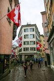 Zurich, Switzerland -16 April 2017. Old street and swiss flags royalty free stock image