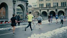 ZURICH, SWITZERLAND - DECEMBER 16, 2018. Amateur city marathon runners. ZURICH, SWITZERLAND - DECEMBER 16 2018 City runners royalty free stock photo