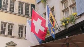 Flags Lantern Emblem Zurich. Zurich, Switzerland - 10 02 2018: The flags of Zurich Switzerland canton emblem on the building stock video footage