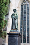 Zurich Switzerland Historical Building. A statue of Huldrych Zwingli and a historical building with long arch gothic windows Royalty Free Stock Photos