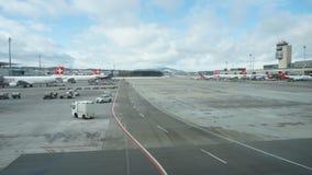 ZURICH, SWITZERLAND - JANUARY : Zurich international Airport at observing area on January 30, 2015 in Zurich, Switzerland. ZURICH, SWITZERLAND - JANUARY : Cloudy stock video footage