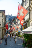 Zurich, Switzerland. 21 July, 2013: Old street in Zurich decorated with flags for the Swiss National Day Royalty Free Stock Image