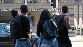 Zurich, Switzerland - 10 June, 2018: gang of teenagers hanging out in urban environment. Professional shot in 4K resolution. 02. You can use it e.g. in your stock video