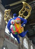 Zurich, Switzerland - June 03, 2017: View of a statue of a guard. Ian angel by Niki de Saint Phalle situated inside of the main railway station Zurich royalty free stock image