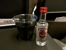 ZURICH, SWITZERLAND - MAR 31st, 2015: SWISS Serves Alcohol In Economy Class On A Long Haul Flight, Enjoy Vodka Coke Royalty Free Stock Images