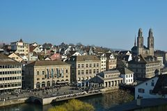 City of Zurich with dominant Grossmunster church on sunny spring royalty free stock images