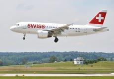 ZURICH, SWITZERLAND - MAY 25, 2014: Swiss airplane landing in Zu Stock Photography