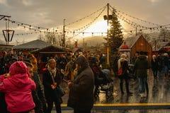 People enjoying christmas atmosphere on christmas market in Zuri royalty free stock image