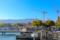 Zurich, Switzerland - Oct 13, 2018 : cranes with lights on city working at blue sky and clouds in summer, buildings under. Construction stock images