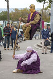 ZURICH/ SWITZERLAND - SEPTEMBER 30, 2012: Street performers put. People watch street performers put on a show Stock Photo