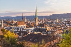 Rooftops and the Zurich Skyline at sunset Stock Images