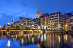 Zurich, Switzerland. Twilight scene in Zurich, Switzerland with the old city reflecting in the waters of Limmat river as it flows into the Zurich Lake Royalty Free Stock Photo