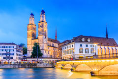 Zurich, Switzerland. View of the historic city center with famous Grossmunster Church, on the Limmat river Royalty Free Stock Photo