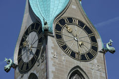 Zurich time. Clock tower in the middle of Zürich, Switzerland royalty free stock images