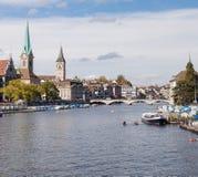 Zurich, view along the Limmat river. Zurich, Switzerland - view along the Limmat river. Stadthaus, Lady Minster, St. Peter Church, Münsterbrücke, Wasserkirche Stock Photos