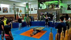 Zurkhaneh sport club in Kerman. KERMAN, IRAN - OCTOBER 15, 2017: The trainer in Zurkhaneh House of Strength sport club performs the exercise with heavy wooden stock footage
