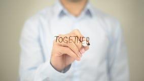 Zusammen Mann-Schreiben auf transparentem Schirm Lizenzfreie Stockfotos