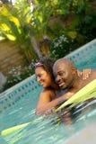 Zusammen schwimmen Stockbild