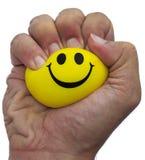 Zusammendrücken eines Druckballs mit einer Hand Stockfotografie