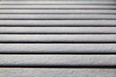 Zusammenfassung des Schnees auf Bank Stockfoto