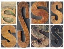 Zusammenfassung des Zeichens S im hölzernen Typen Lizenzfreie Stockbilder