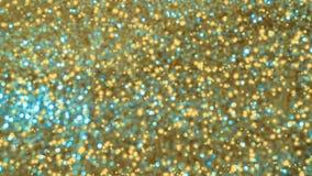 Zusammenfassung goldenes glänzendes bokeh auf hellem abgetöntem Hintergrund Glühender Hintergrund mit bokeh Art für Saisongrüße lizenzfreie stockfotos