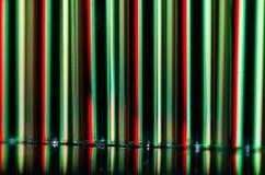 Zusammenfassung: Vertikale Streifen des roten und grünen Lichtes, das einen Feiertags-Hintergrund bildet Lizenzfreie Stockfotos