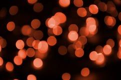 Zusammenfassung verwischt vom roten funkelnden Glanzbirnenlichthintergrund Unschärfe des Weihnachtstapeten-Dekorationskonzeptes lizenzfreies stockbild