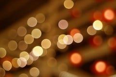 Zusammenfassung verwischte verzierte Innenbeleuchtung in den braunen und orange Farbabstufungen Stockbild