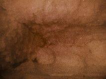 Zusammenfassungsbraun schattierte strukturierten Hintergrund Papierschmutzhintergrundbeschaffenheit Eine Abbildung einer Batikaus lizenzfreie stockfotografie