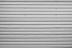 Zusammenfassungshintergrund runzelte das graue Metall für Wand, metallisch stockfoto