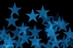 Zusammenfassungsunschärfe der blauen Sterne Lizenzfreie Stockfotos