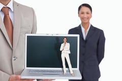 Zusammengesetztes Bild der denkenden Geschäftsfrau Lizenzfreie Stockbilder