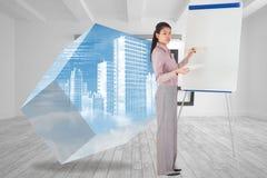 Zusammengesetztes Bild der Geschäftsfraumalerei auf einem Gestell Lizenzfreie Stockfotos