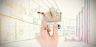 Zusammengesetztes Bild der Hand Haus zeigend Lizenzfreie Stockbilder