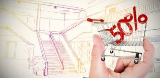 Zusammengesetztes Bild der Hand Holzhaus zeigend Lizenzfreies Stockfoto