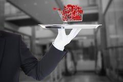 Zusammengesetztes Bild der Hand mit den Handschuhen, die ein Silbertablett halten Lizenzfreie Stockfotografie