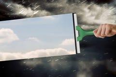Zusammengesetztes Bild der Hand unter Verwendung des Wischers Lizenzfreie Stockfotos