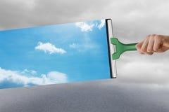 Zusammengesetztes Bild der Hand unter Verwendung des Wischers Stockfoto