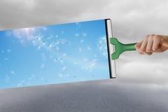 Zusammengesetztes Bild der Hand unter Verwendung des Wischers Stockfotografie
