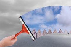 Zusammengesetztes Bild der Hand unter Verwendung des Wischers Lizenzfreies Stockbild