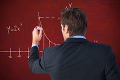 Zusammengesetztes Bild der hinteren Ansicht der Geschäftsmannstellung und -schreibens Stockbilder