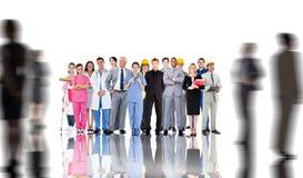 Zusammengesetztes Bild der lächelnden Gruppe von Personen mit verschiedenen Jobs Lizenzfreies Stockbild