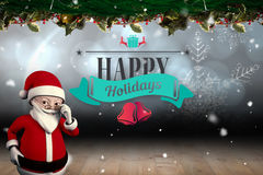 Zusammengesetztes Bild der netten Karikatur Weihnachtsmann Lizenzfreie Stockbilder