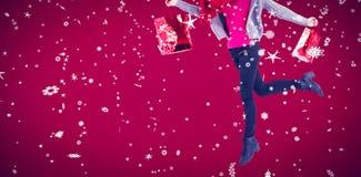 Zusammengesetztes Bild der recht blonden Aufstellung im Winter kleidet Lizenzfreies Stockbild