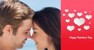 Zusammengesetztes Bild des Abschlusses herauf Ansicht von romantischen Paaren Lizenzfreie Stockbilder