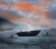 Zusammengesetztes Bild des attraktiven Architekten schreiend in einem Segelboot stockbilder