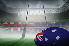 Zusammengesetztes Bild des australischen Flaggenrugbyballs Stockfotos